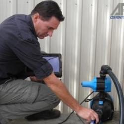 View Photo: Inspecting Pump
