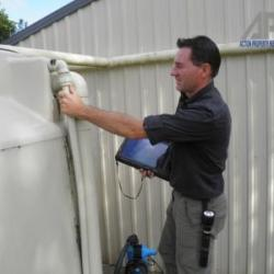 View Photo: Inspecting Water Tank