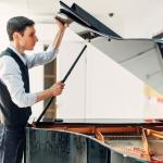 Piano movers cost & DIY tips to move it safely.