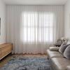 Wave fold sheer curtain in Lounge