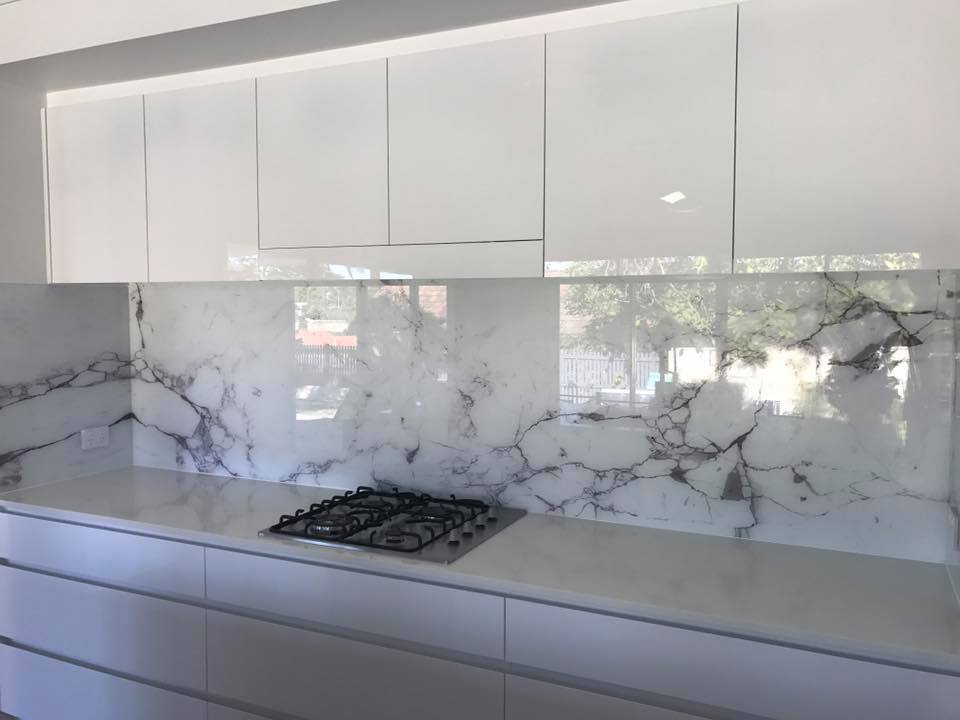 View Photo: Splashback with image of Calcutta Stone.