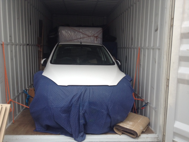 View Photo: Transport a car in a shipping container