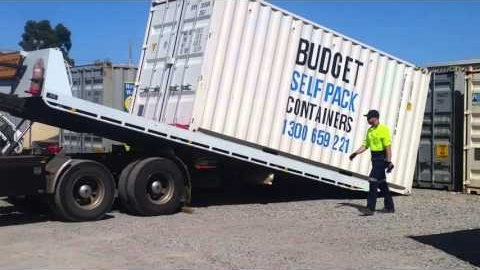Watch Video : Removalist moving container - unload into depot