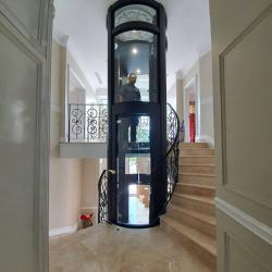 View Photo: Italian engineering with a bespoke cylindrical glass shaft