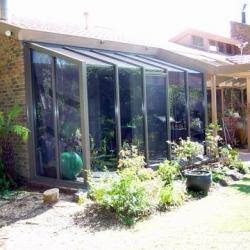 View Photo: Commercial Aluminium Hooded Garden Window Replacement