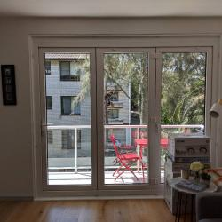 View Photo: A balcony door that protects from the elements!