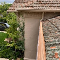 View Photo: Triple-G gutter guard on a tiled terracotta roof