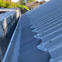 View Photo: Corrugated roof ember mesh