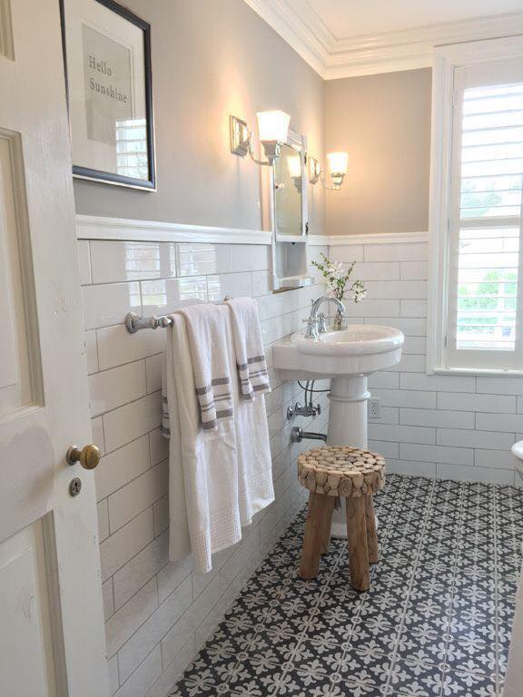 Change your bathrooms look inexpensively with painted tiles