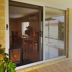 View Photo: Sliding security door with a pet door
