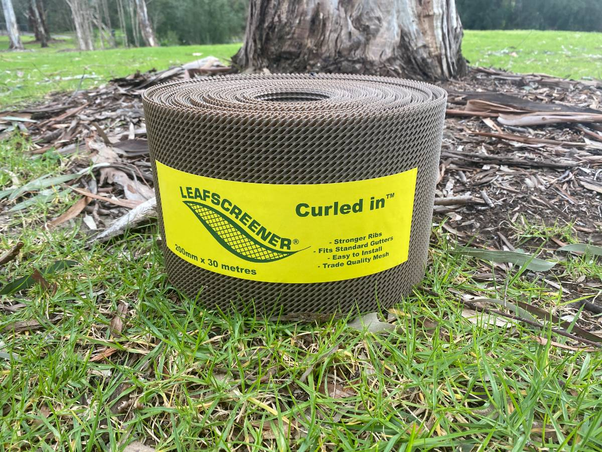 View Photo: Curled In™ Gutter Guard in the brown colour
