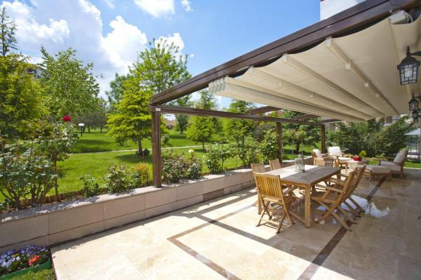 Sunlux Retractable Pergola Awning with integrated gutter