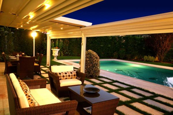View Photo: Sunlux Retractable Pergola awning with integrated lighting