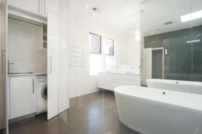 View Photo: Mirrors Promote Spaciousness in Bathrooms