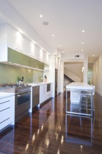 Colour coordination between kitchen and home photo for Galley kitchen with island bench