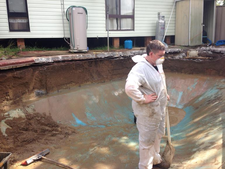 View Photo: Compressed Asbestos Cement walls of a pool removed