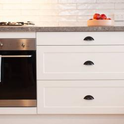 View Photo: Wide cabinetry to hold pots and pans